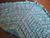 Finished, but unblocked shawl. So bunchy and small!